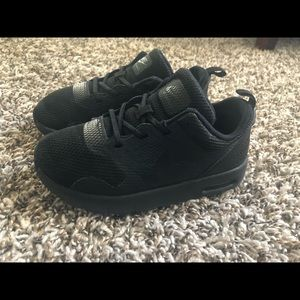 All Black Nike Tavas